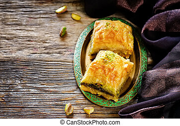 baklava with pistachio. turkish traditional delight on a...