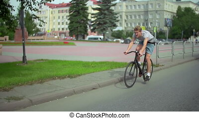 Alternative to Automobile - Tracking shot of man riding...