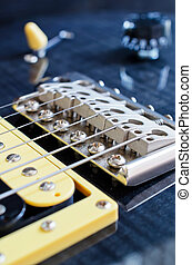 Detail of six-string electric guitar closeup, selective...