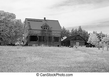 Farmhouse In Infrared - An old pioneer farmhouse in a field...