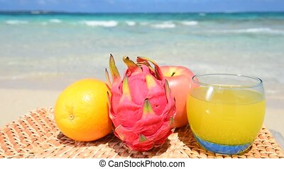 Gorgeous Beach in Summertime - Exotic tropical fruit on the...