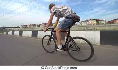 New Bicycle - Man cycling on the roadway
