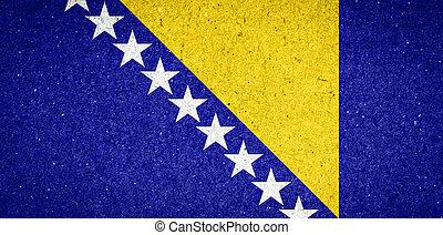 Bosnia and Herzegovina flag on paper background