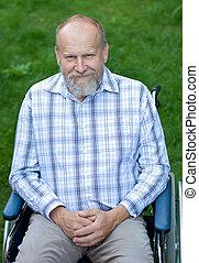 Handicap businessman - Handicapped elderly man sitting in a...