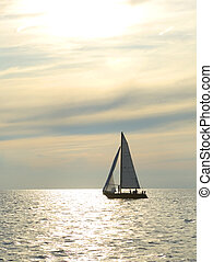 Sunset sail - sailboat on the water at dusk with great...
