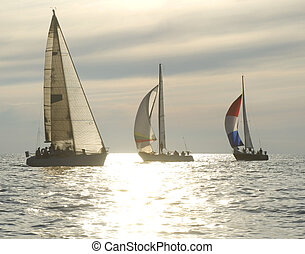 Sunset yacht race - sailboats rounding a mark in a sunset...