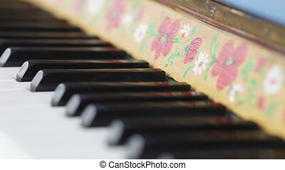Antique piano - Decorated with national ornaments antique...