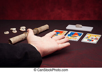 Clairvoyance equipment with palm on dark desk