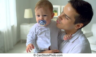 Sweet Boy - Close up of young father babysitting with his...