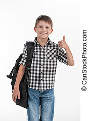 Happy schoolboy wearing backpack and giving thumbs up cute...