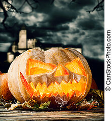 Halloween pumpkin on wood with dark background - Concept of...