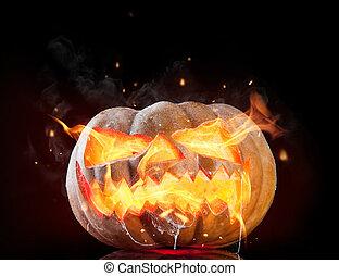 Burning pumpkin - Halloween pumpkin with fire flames...