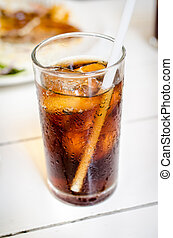 Cola with ice in a glass - Cola with ice and bubble in a...