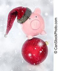 Piggy bank on a Christmas ball in a glittery background