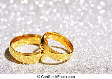 Two rings - Two golden rings on white glitter background