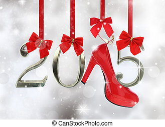 High heel shoe and 2015 number hanging on red ribbons in a...