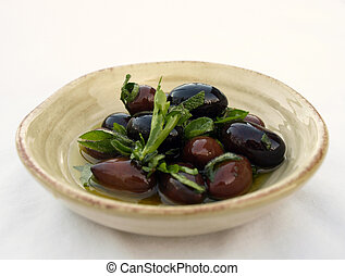 Olives and herbs in bowl - Kalamata olives and herbs in dish