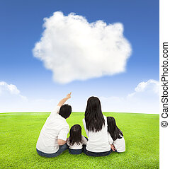 happy family on a meadow with cloud background