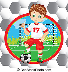 Boy soccer player on the background of a football goal with...