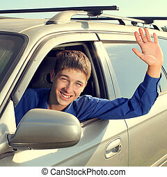 Teenager in a Car - Toned photo of Happy Teenager sitting in...
