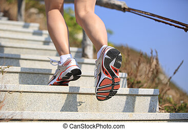 sports legs running on stairs