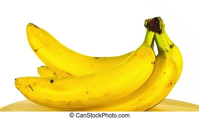 branch of bananas rotates on a white background