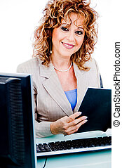 Corporate woman looking at file work