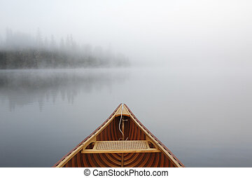 Canoeing on a Misty Lake - Cedar Canoe Bow on a Misty Lake -...