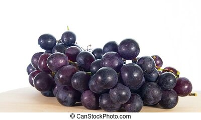 black grapes rotates, white backgro