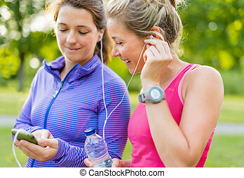 friendship and fitness in the parc - Group of two female...