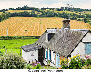 peasant farm and harvested field in Normandy, France