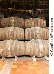 port wine barrels - rows of traditional aged wooden port...