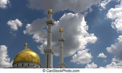 Mosque and Minarets - Beautiful golden dome of the mosque on...