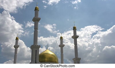 White Clouds Over the Mosque - Beautiful golden dome of the...