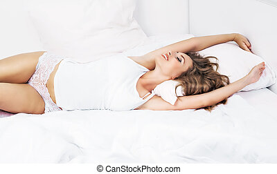 woman waking up - young woman with long beautiful hair...