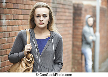 Teenage Girl Feeling Intimidated As She Walks Home
