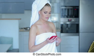Woman in Bath Towel Talking on Cell Phone - Young Woman...