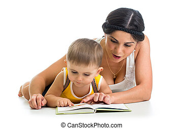 mother reading a book to her kid boy