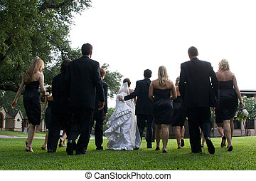 Bridal Party - Bride\'s Maids and Groomsmend walking...