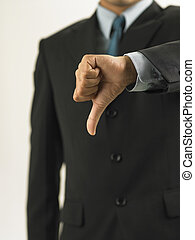 businessman showing handsign no good - a businessman showing...