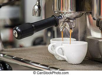 prepares espresso in his coffee shop