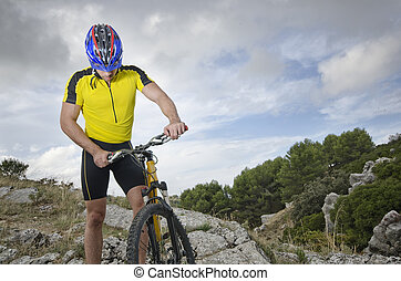 Biker man resting - Mountain biker resting near to his...