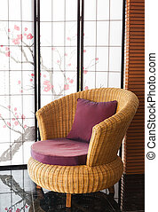 Red upholstered chair in living room with flowers
