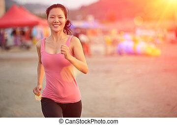 woman running at beach - healthy lifestyle beautiful asian...