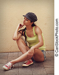 Beautiful trendy urban young woman in shorts. Vintage...
