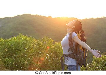 woman hiker open arms sunrise - thankful woman hiker open...