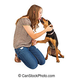 Mixed Breed Dog and Young Lady - A pretty young girl shaking...