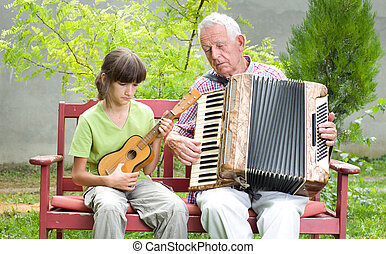 Guitar and accordion - Girl and grandpa playing musical...