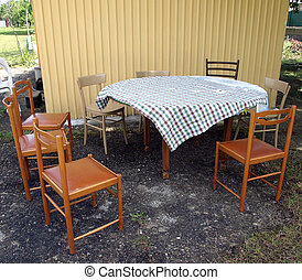 Picnic table with chairs and checked tablecloth