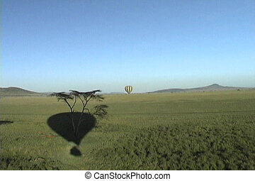 Hot air balloon drifting over the Serengeti Plains in Africa